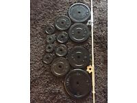 Solid cast iron weight plates with solid long bar / barbell