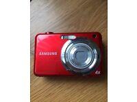2 Samsung digital cameras