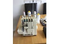 Sewing machine singer overlocker