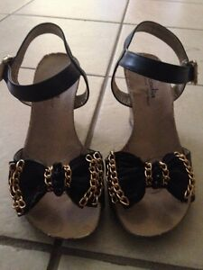 Black and gold wedge sandals size 5.5