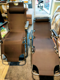 Two fully adjustable black garden chairs