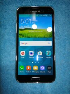 MINT UNLOCKED Samsung Galaxy S5 in 9.9/10 condition FIRM $185
