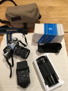Olympus 35mm SLR camera, 200 mm lens, flash, & bag