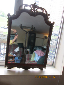 Antique mirror with carved frame