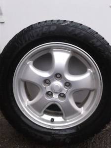 FORD-Aluminum rim and tire...$65 obo