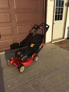 Toro self-propelled three and one lawnmower
