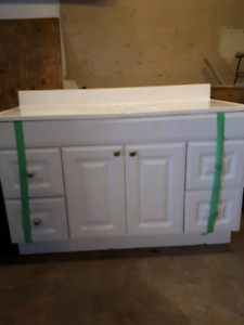"""Vanity and ceramic sink top. 48"""" Actually 48 3/4 inches wide by"""