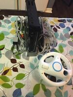 WII Console with steering wheel , stand , power bar & TV hook up