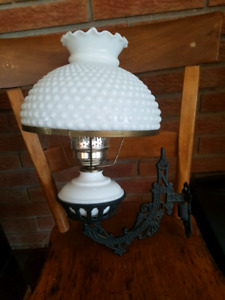 Cast Iron wall mount lamp.