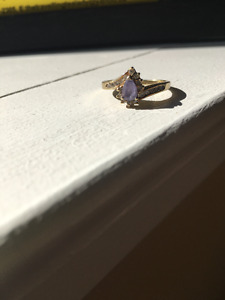 Tanzanite Ring with 19 small diamonds and a tear drop Tanzanite
