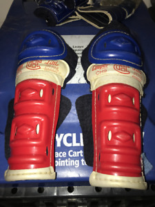 VINTAGE PAIR OF LITTLE NHL MONTREAL CANADIENS CHILD  SHIN PADS
