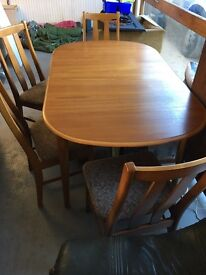 Fantastic wood extending table and four chairs
