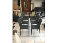 Grey Coloured Padded Dining Chairs In A Material Finished Covering(£30 each)