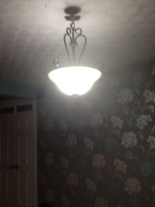 Wrought iron ceiling light with greyish light bowl