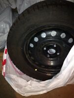 Nearly new Set of 4 Winter Tires on Rims