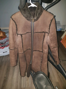 Mutton and leather coat