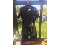 Wet suit , short legs and arms Gul large never worn
