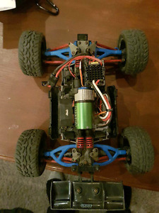 TODAY ONLY. Two 1/16 e-revo's with 1/10 motors and tons of parts