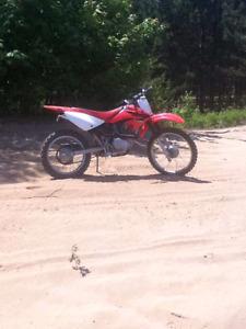 Motocross a vendre ou a echanger contre 4 roue  sport en ordre