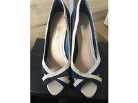 Navy and cream Heels