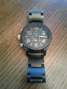 Men's Nixon 51-30 matte black and gold divers watch. 9.5/10