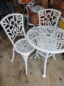 CAST IRON TABLE AND TWO CHAIRS