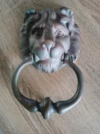 Old solid brass loin door knocker