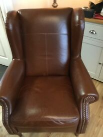 Lovely dark brown leather queen Ann arm chair