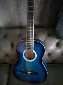 Blue acoustic guitar with carry case excellent condition.