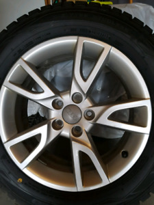 Set of Dunlop Winter Maxx Tires and Audi OEM alloy rims for sale
