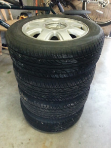 Nearly New 185 60 R14 All Season Tires on Rims