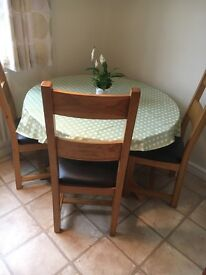 Solid oak and glass circular table