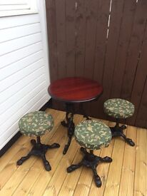 Cast iron table with 3 stools