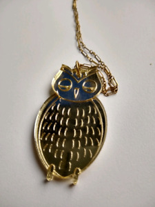 Gold-coloured owl necklace