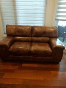 2 Real leather Couch for sale discoloured due too sun.
