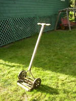 Old wood handled push mower