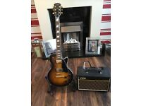 Les Paul copy guitar electric bought as a gift for husband but was never even used