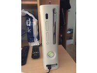 Xbox 360 plus 3-4 controllers / charger lead + 12 games & turtle beach headset