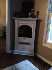 White electric corner fire place