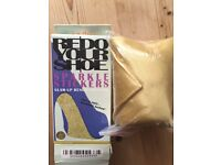 Gold shoe soles and yellow/gold tie