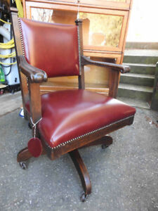Antique swivel office chair, restored with new burgundy leather