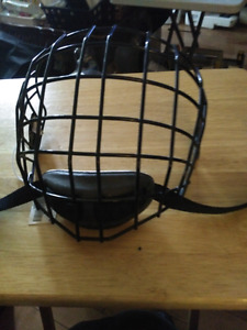 Full face cage for hockey player size large.