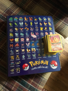 Over 100 Pokemon Cards, including holographic w/ protective book
