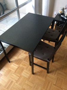 Black IKEA table with 2 wooden chairs - great condition