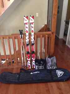 140cm Atomic Skis with poles, boots and bags