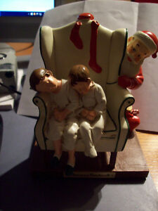 Norman Rockwell figurine of Santa and sleeping kids