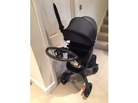 Stokke Xplory V4 True Black edition with iZiGo Car seat and accessories.