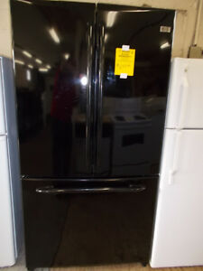 GE profile fridge with french doors. Black in color. $599.