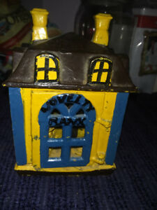 Cast Iron Novelty Bank with pennies free