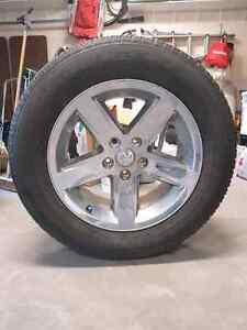 Dodge ram 1500 tires and rims. (p275/60R20) (5x139.7)